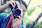 Brunette taking a photo outside — Stock Photo