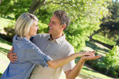 Couple dancing in park — Stock Photo