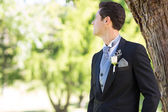 Groom looking away in garden — Stock Photo