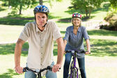 Couple bike riding in park — Stock Photo