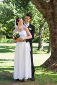Newly wed couple in park — Stock Photo