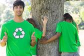 Environmentalist gesturing thumbs up in park — Stock Photo