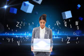 Businesswoman showing laptop with letters — Stock Photo