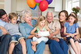 Family celebrating girls birthday — Stockfoto