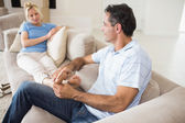 Relaxed couple sitting on sofa — Stock Photo