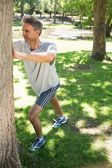 Man stretching against tree — Stock Photo
