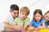 Parents assisting children in coloring  — Stock Photo
