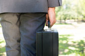 Midsection of businessman carrying briefcase  — Stock Photo