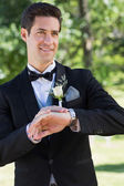 Bridegroom waiting in garden — Stock Photo