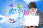 Businessman showing laptop with app icons — Stock Photo