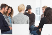 Serious rehab group at a therapy — Stock Photo