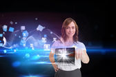 Businesswoman pointing to laptop and profiles behind — Stock Photo