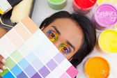 Portrait of a young woman with paint samples — Stock Photo