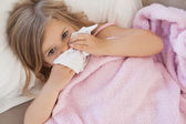 Girl suffering from cold — Stock Photo