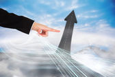 Finger pointing to road turning into arrow — Stock Photo