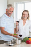 Happy couple making dinner together — Stock Photo