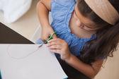 Girl cutting chart paper — Stock Photo