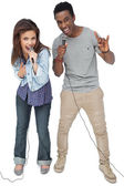 Couple singing into microphones — Stock Photo