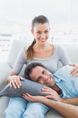 Happy couple relaxing on the couch together — Stock Photo
