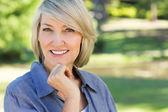 Portrait of happy woman in park — Stock Photo