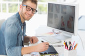 Handsome editor working with digitizer — Stock Photo