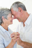 Happy senior couple dancing together head to head — Stock Photo