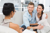 Smiling couple reconciling at therapy session — Stock Photo