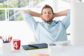 Designer relaxing at his desk — Stock Photo