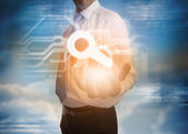 Businessman presenting magnifying glass graphic — Foto Stock