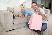Couple doing online shopping at home — Stock Photo