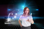 Businesswoman pointing with laptop and profiles behind — Stock Photo