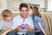 Loving children gifting father — Stock Photo