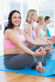 Pregnant women meditating — Stock Photo