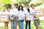 Volunteers carrying donation boxes — Stock Photo