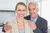 Happy business couple smiling at camera before work in morning — Stock Photo