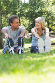 Couple stretching in the park — Stock Photo
