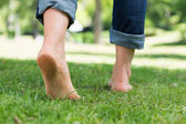 Woman walking on grass — Stock Photo