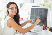 Pretty young editor working — Stock Photo
