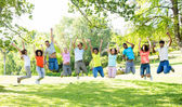 Cheerful friends jumping  — Stock Photo