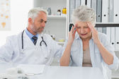 Female senior patient visiting doctor — Stock Photo