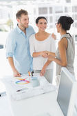Interior designer shaking hands with smiling client — Stock Photo