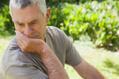 Thoughtful mature man at the park — Stock Photo