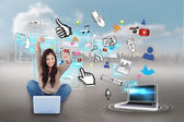 Cheering girl using laptop with app icons — Stock Photo