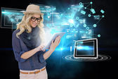 Stylish blonde using tablet pc with interfaces and email icons — Stock Photo