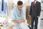 Concentrated male fashion designer at work — Stock Photo