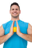 Portrait of a content young man holding stress ball — Stock Photo
