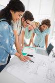 Fashion designers discussing designs — Stock Photo