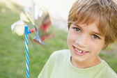 Boy holding pinwheel — Stock Photo