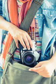 Woman taking camera from her bag — Stock Photo