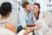 Happy couple reconciling at therapy session — Stock Photo